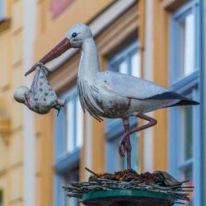 Storch mit Baby Figur